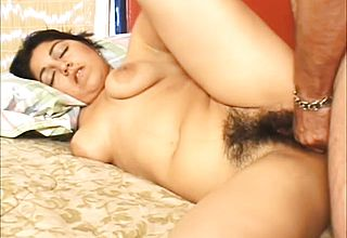 Luscious brunette relishes every deep stroke of dick in her hairy twat