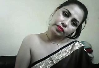 hot desi girl on cam showing boobs and teasing in a saree wi